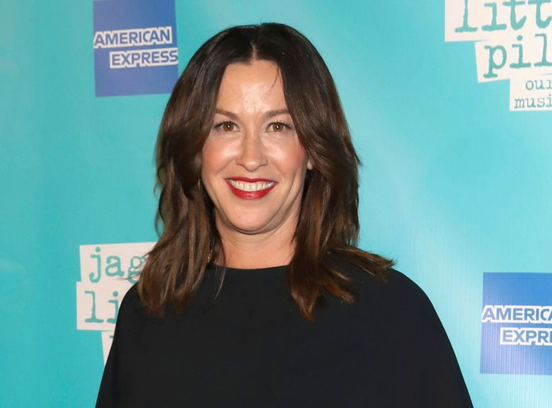 """FILE – Alanis Morissette attends the """"Jagged Little Pill"""" Broadway opening night in New York on Dec. 5, 2019. Just hours before the HBO documentary """"Jagged"""" was to premiere at the Toronto International Film Festival on Tuesday, Alanis Morissette criticized the film about her life as """"reductive"""" and """"salacious."""" Morissette participated in the film, directed by Alison Klayman, sitting for lengthy interviews. But in a statement issued by her publicist, Morissette said she would not be supporting the film. (Photo by Greg Allen/Invision/AP, File)"""