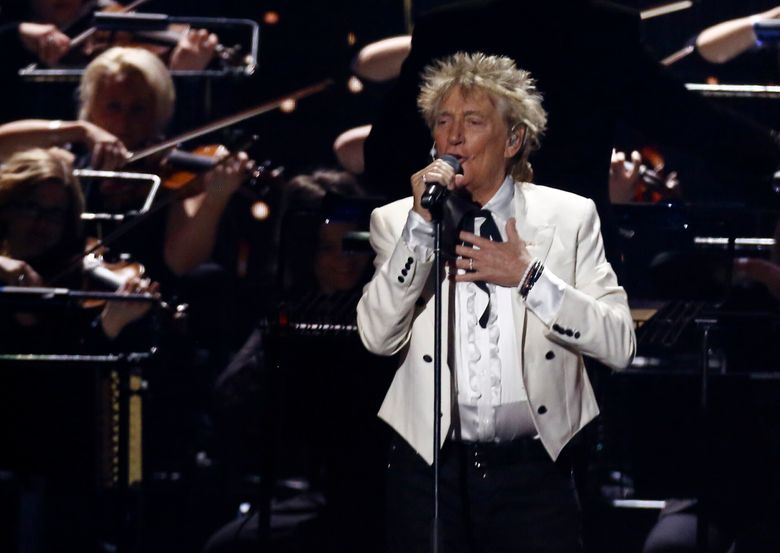 """FILE – In this Feb. 18, 2020 file photo, Rod Stewart performs on stage at the Brit Awards 2020 in London. A Florida judge on Thursday, Sept. 9, 2021, has canceled the trial for Stewart and his adult son and scheduled a hearing next month to discuss a plea deal to resolve misdemeanor charges. The singer of 70s hits such as """"Da Ya Think I'm Sexy?"""" and """"Maggie May"""" and his son are accused of pushing and shoving a security guard at an upscale hotel because he wouldn't let them into a New Year's Eve party nearly two years ago.  (Photo by Joel C Ryan/Invision/AP, File)"""