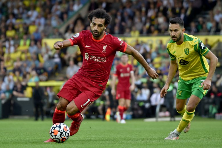 FILE – In this Aug. 14, 2021 file photo, Liverpool's Mohamed Salah runs with the ball during the English Premier League soccer match against Norwich City at Carrow Road Stadium in Norwich, England. Egypt's soccer association on Saturday, Sept. 4, says Salah has arrived in Gabon to join the Pharaohs for their World Cup qualifying match.  (AP photo/Rui Vieira, File)