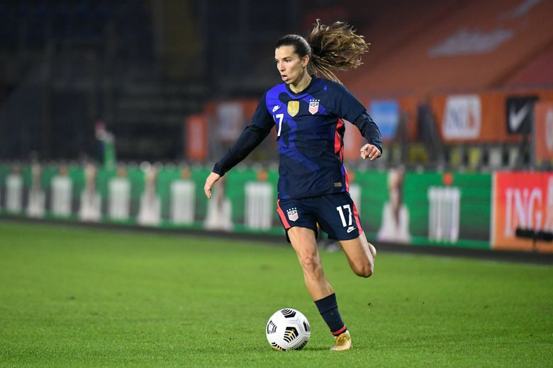 FILE – In this Friday Nov. 27, 2020 file photo, United States' Tobin Heath plays the ball during their international friendly women's soccer match against The Netherlands at the Rat Verlegh stadium in Breda, Netherlands. United States international Tobin Heath is staying in English soccer. The 33-year-old forward has signed for Arsenal in the Women's Super League on Friday, Sept. 3, 2021. She played at Manchester United last season. (Piroschka van de Wouw/Pool via AP, file)