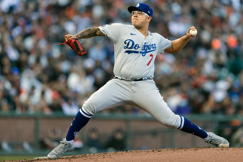 Los Angeles Dodgers starting pitcher Julio Urias works against the San Francisco Giants in the first inning of a baseball game in San Francisco, Saturday, Sept. 4, 2021. (AP Photo/John Hefti)