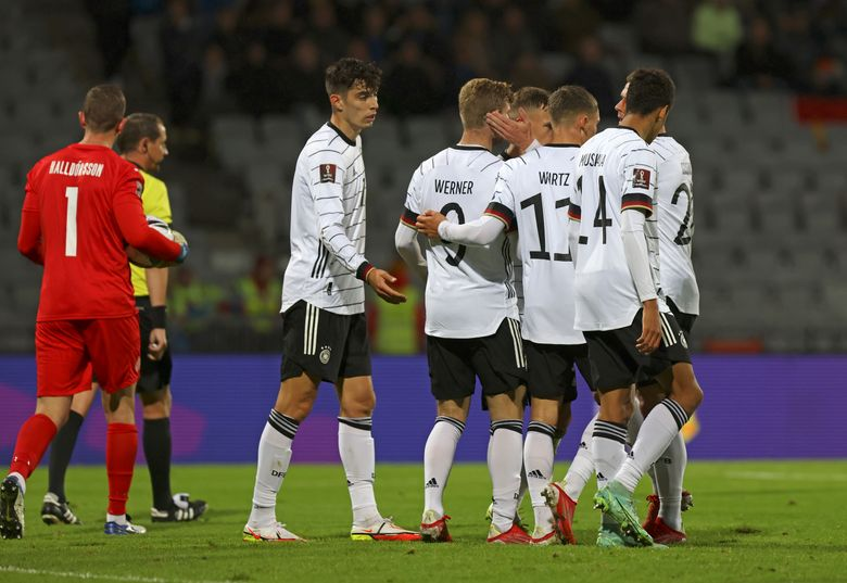 Germany players celebrate after Timo Werner scored their fourth goal during the World Cup 2022 group J qualifying soccer match between Iceland and Germany in Reykjavik, Iceland, Wednesday Sept. 8. 2021. (AP Photo/Arni Torfason)