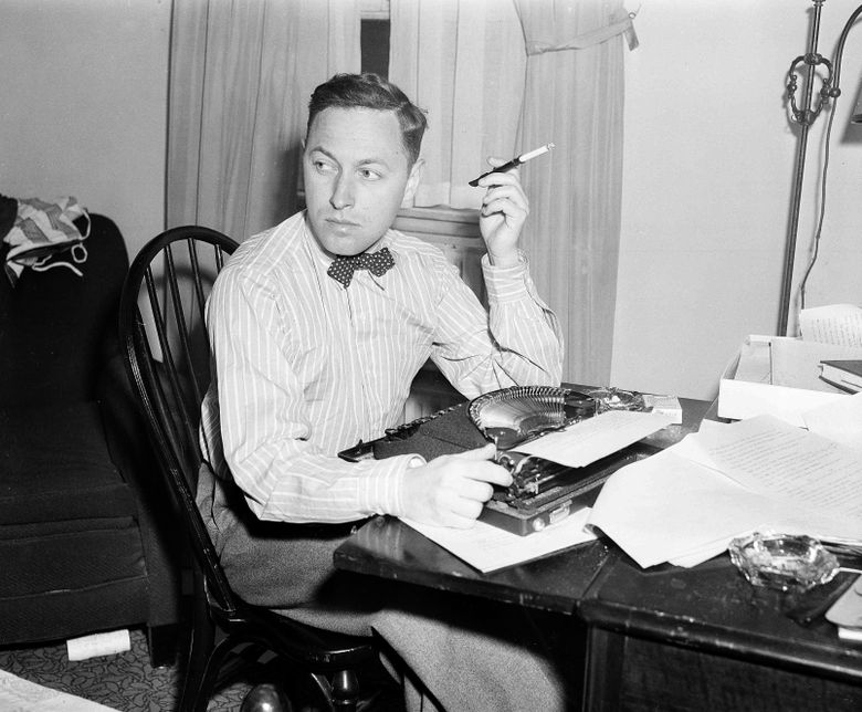 """FILE – This Nov. 11, 1940 file photo shows playwright Tennessee Williams at his typewriter in New York. A rarely seen Williams short story """"The Summer Woman"""" appears in the fall issue of the literary quarterly The Strand Magazine. (AP Photo/Dan Grossi, File)"""