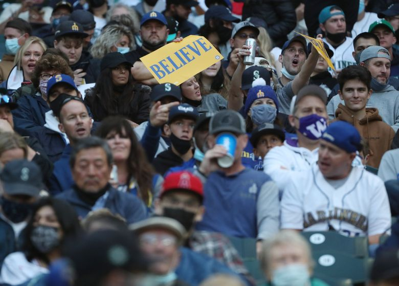 Fans fill the stands as the Mariners take on the Angels, Saturday, Oct. 2, 2021 in Seattle.   218402 (Ken Lambert / The Seattle Times)