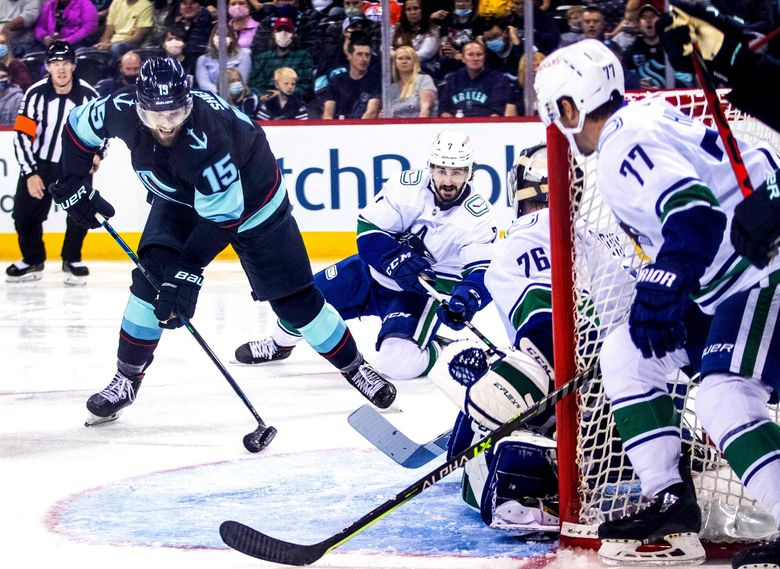 Seattle's Riley Sheahan (15) ties the game at 2 with this goal during a preseason game against the Vancouver Canucks, Sept. 26, 2021, in Spokane. (Dean Rutz / The Seattle Times)