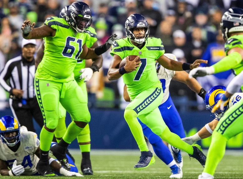 Geno Smith takes off running as he substitutes Russell Wilson in the second half against the Los Angeles Rams Thursday, October 7, 2021 in Seattle. (Dean Rutz / The Seattle Times)