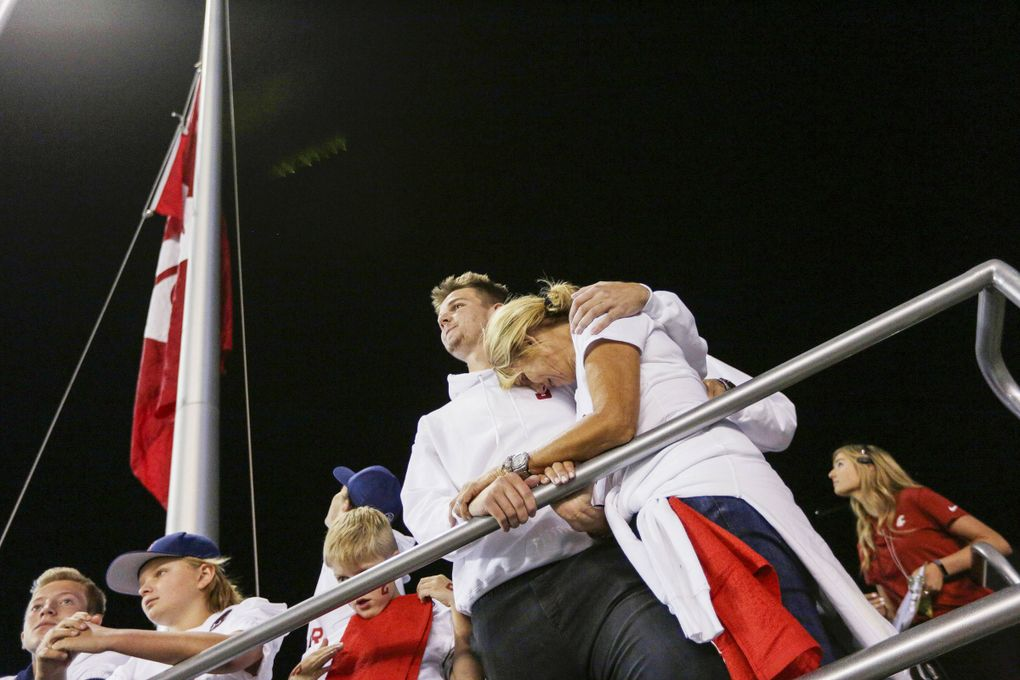 Ryan comforting his mother, Kym, at a Washington State game in September 2018, after Tyler's death. (Young Kwak / AP)