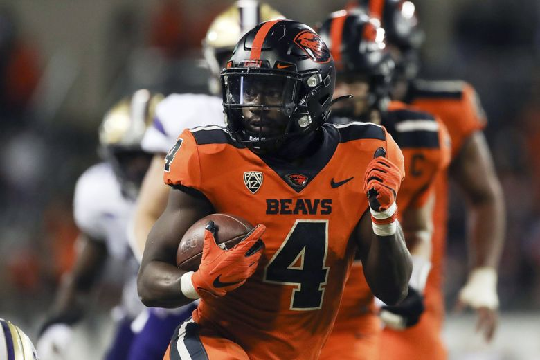 Oregon State running back B.J. Baylor rushes for 27-yards to score a touchdown during a game against Washington, Oct. 2, 2021, in Corvallis, Ore. (Amanda Loman / AP)