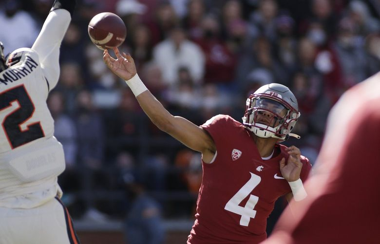 Washington State quarterback Jayden de Laura (4) throws a pass during the first half of an NCAA college football game against Oregon State, Saturday, Oct. 9, 2021, in Pullman, Wash. (AP Photo/Young Kwak) OTK OTK