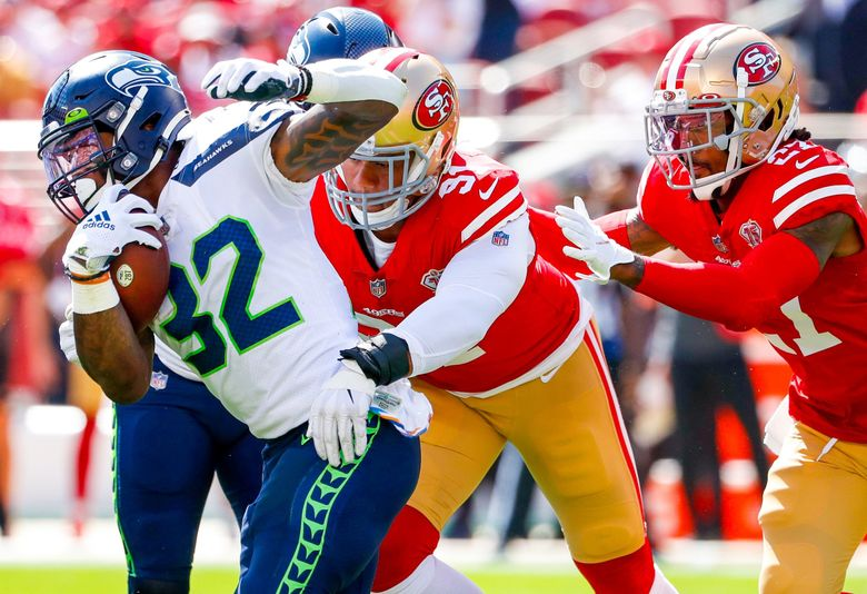 Seattle Seahawks running back Chris Carson tries to rush the ball against the San Francisco 49ers during a game Oct. 3, 2021, in Santa Clara, Calif. (Jennifer Buchanan / The Seattle Times)