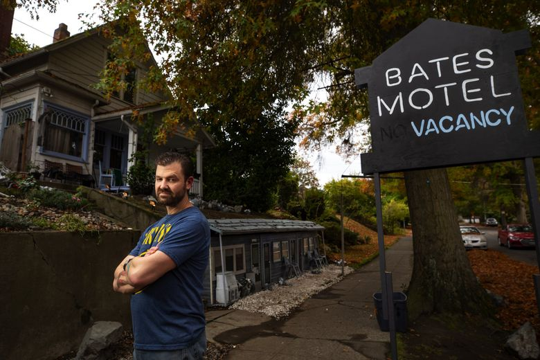 """Richard Knowles has created a grayscale model of the Bates Motel, where Alfred Hitchcock's 1960 film """"Psycho"""" was set, in front of his Queen Anne home for Halloween, a tradition he's carried on for several years. (Bettina Hansen / The Seattle Times)"""