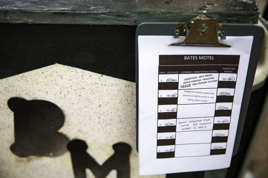 """A close-up of the maid's cart, at the mini Bates Motel that Queen Anne resident Richard Knowles has built, reveals notes such as """"NEEDS new shower curtain,"""" a nod to the famous shower scene in """"Psycho."""" (Bettina Hansen / The Seattle Times)"""