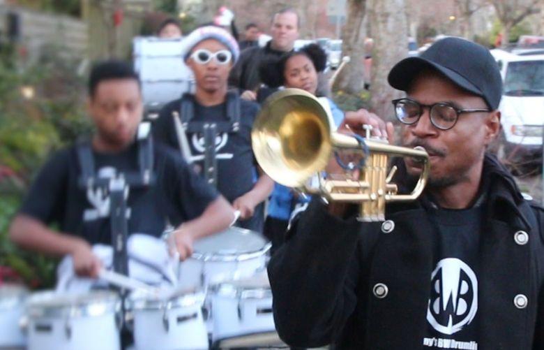 Owuor Arunga playing trumpet during Walk the Block 2020 at Garfield Community Center.
