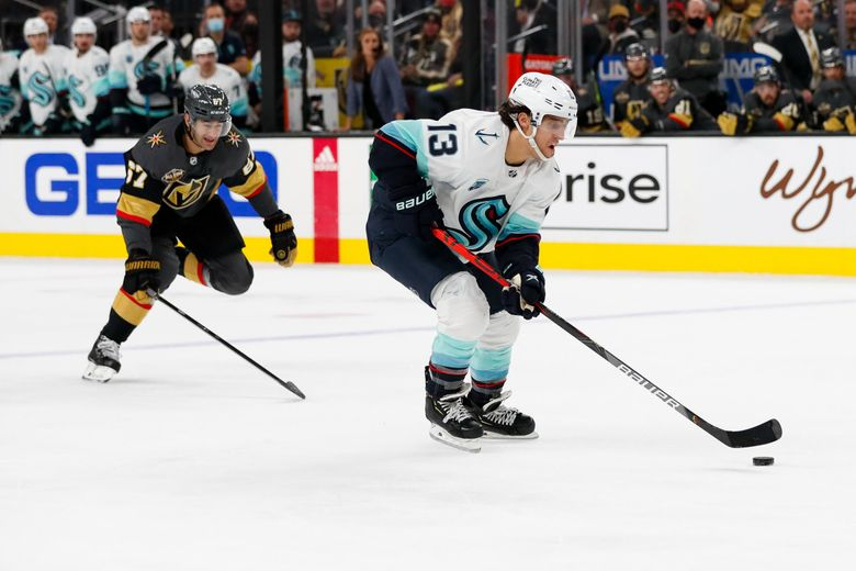 Seattle Kraken left wing Brandon Tanev takes off down the ice as Vegas Golden Knights left wing Max Pacioretty trails the play during the first period Tuesday, Oct. 12, 2021, in Las Vegas. (Jennifer Buchanan / The Seattle Times)