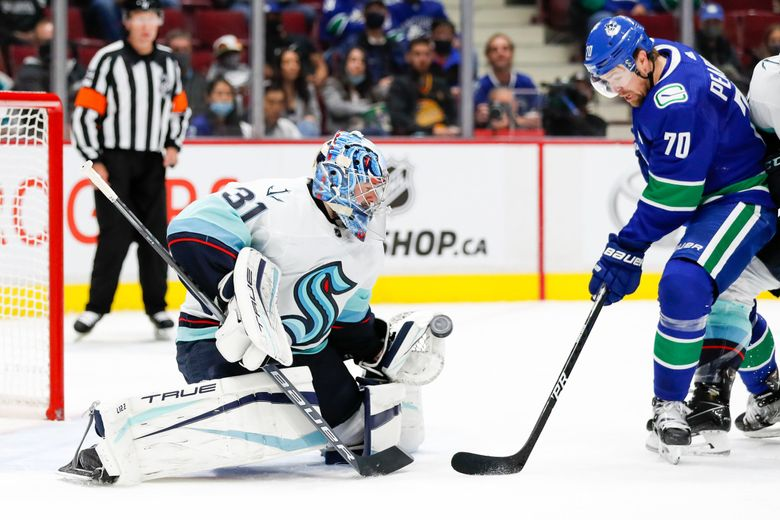 Seattle Kraken goaltender Philipp Grubauer makes a glove save on a shot by Vancouver Canucks left wing Tanner Pearson during the second period on Oct. 5, in Vancouver, BC. (Jennifer Buchanan / The Seattle Times)