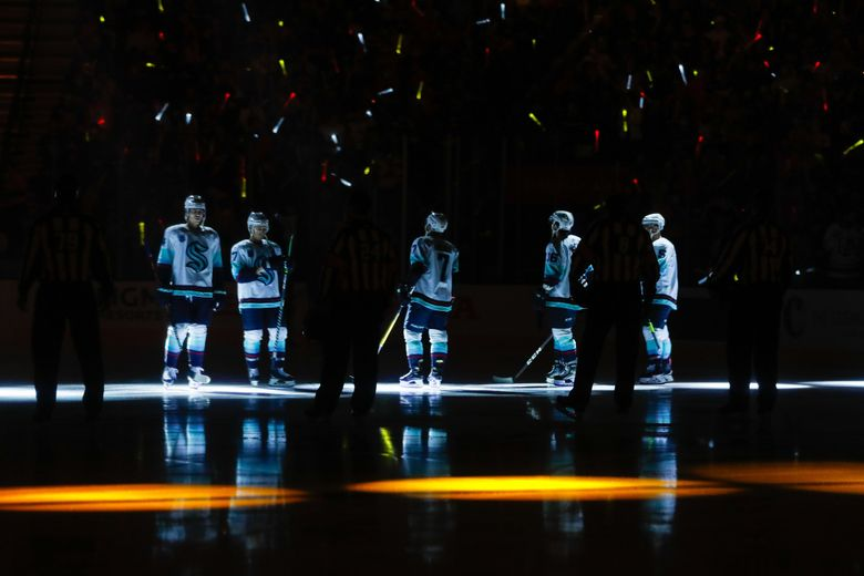 The starting lineup for the Seattle Kraken take the ice before the start of their game against the Vegas Golden Knights Tuesday, Oct. 12, 2021, in Las Vegas. (Jennifer Buchanan / The Seattle Times)