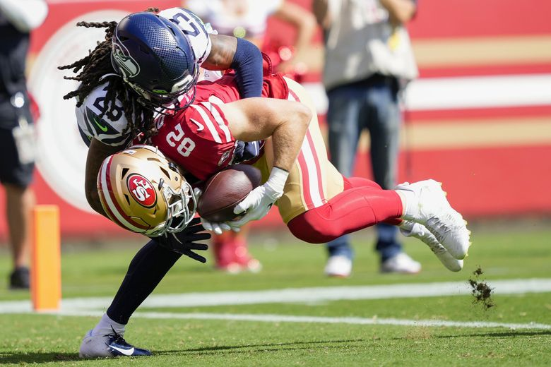 San Francisco 49ers tight end Ross Dwelley (82) catches a touchdown pass against Seattle Seahawks cornerback Sidney Jones during a game in Santa Clara, Calif., Oct. 3, 2021. (Tony Avelar / AP)