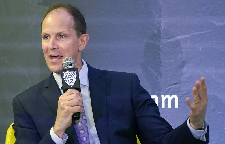 Washington head coach Mike Hopkins speaks during Pac-12 Conference NCAA college basketball media day Wednesday, Oct. 13, 2021, in San Francisco. (AP Photo/Jeff Chiu) CAJC124