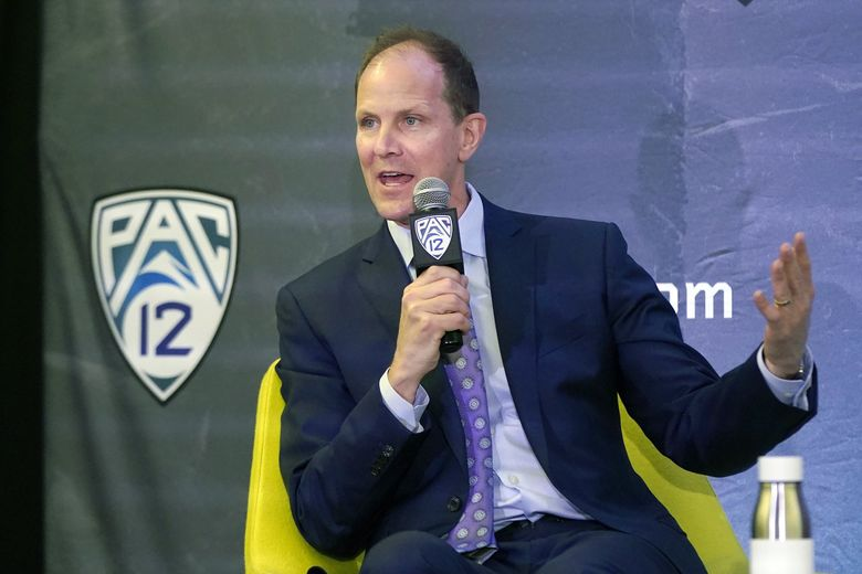 Washington head coach Mike Hopkins speaks during Pac-12 Conference basketball media day Wednesday, Oct. 13, 2021, in San Francisco. (Jeff Chiu / AP)