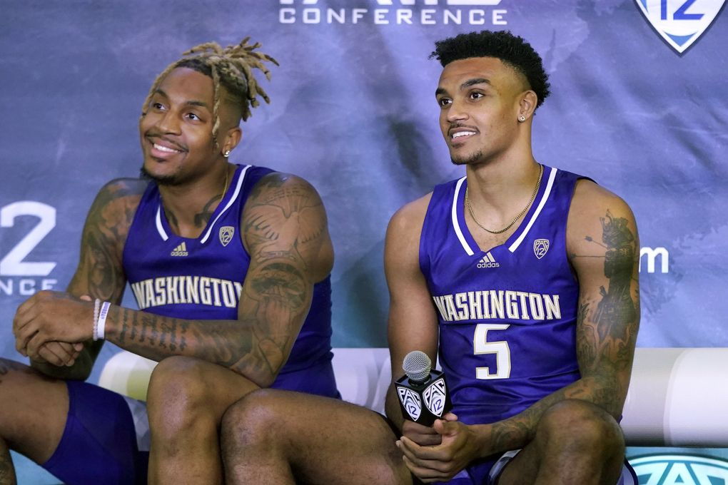 Washington's Nate Roberts, left, and Jamal Bey listen to questions during Pac-12 Conference basketball media day Wednesday, Oct. 13, 2021, in San Francisco. (Jeff Chiu / AP)