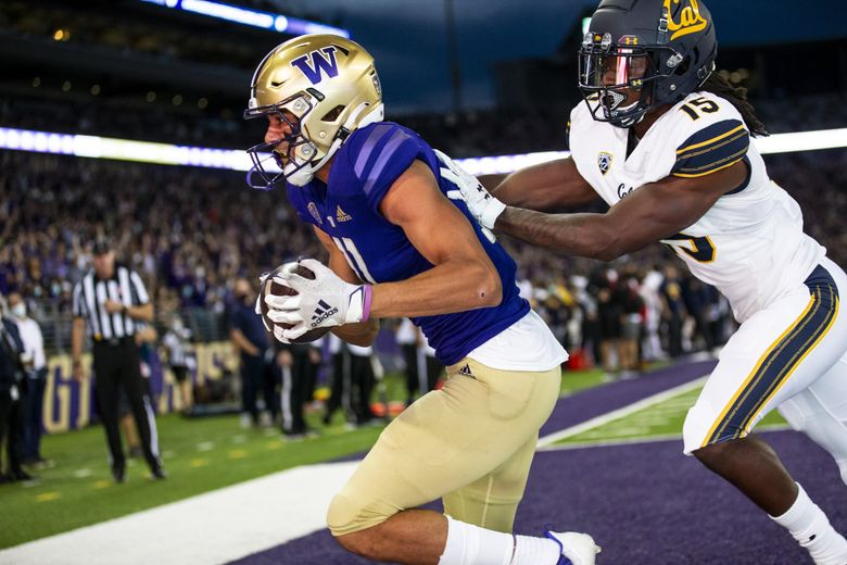 Washington's Jalen McMillan secures the ball after catching a pass against California, Sept. 25, 2021 in Seattle. (Amanda Snyder / The Seattle Times)