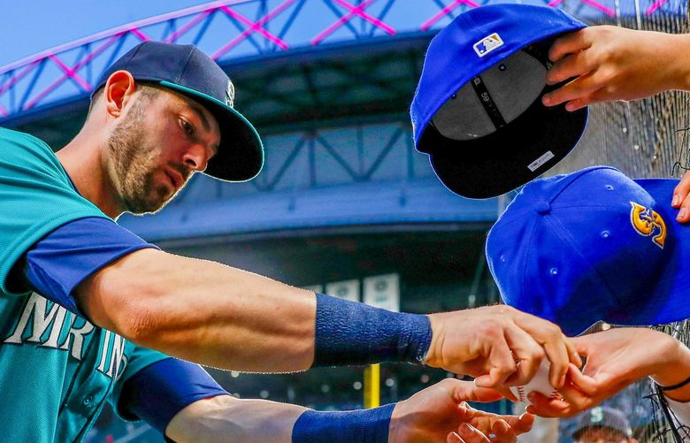 T-Mobile Park – Seattle Mariners vs. Los Angeles Angels – 100121  Seattle Mariners right fielder Mitch Haniger signs autographs before the start of a game against the Los Angeles Angels Friday, Oct. 1, 2021, in Seattle. 218395 218395