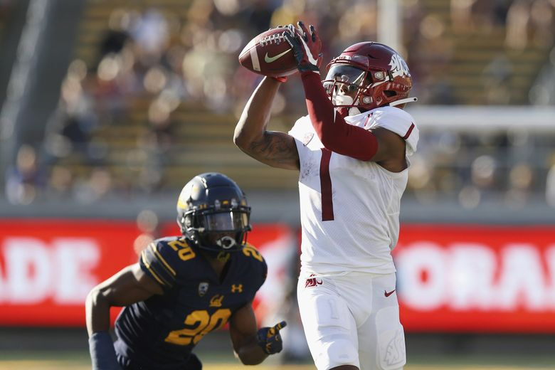 Washington State Cougars wide receiver Travell Harris catches a pass against California Golden Bears cornerback Josh Drayden during a game, Oct. 2, 2021 in Berkeley, Calif. (Lachlan Cunningham / AP)