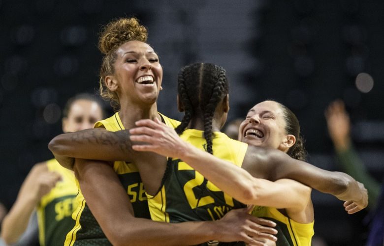 Mercedes Russell and Sue Bird grab Jewell Loyd following her game-winning shot with 0.8 seconds left on the clock in overtime.  The Dallas Wings played the Seattle Storm in WNBA Basketball Friday, June 4, 2021 at Angel of the Winds Arena in Everett, WA. 217311