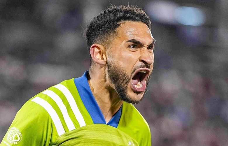 Seattle Sounders midfielder Cristian Roldan (7) celebrates a goal gainst the Colorado Rapidsduring the second half of an MLS soccer match Wednesday, Oct. 20, 2021, in Commerce City, Colo. (AP Photo/Jack Dempsey) COJD110