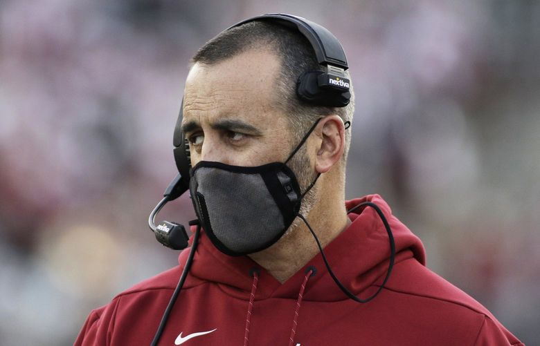 FILE – In this Saturday, Oct. 16, 2021, file photo, Washington State coach Nick Rolovich watches during the first half of an NCAA college football game against Stanford in Pullman, Wash. The NHL suspending San Jose's Evander Kane 21 games for submitting a fake vaccination card and Washington State firing football coach Nick Rolovich for failing to comply with a vaccine mandate Monday provided two more reminders of the impact the coronavirus is still having on professional and college sports. (AP Photo/Young Kwak, File) NYDD205 NYDD205