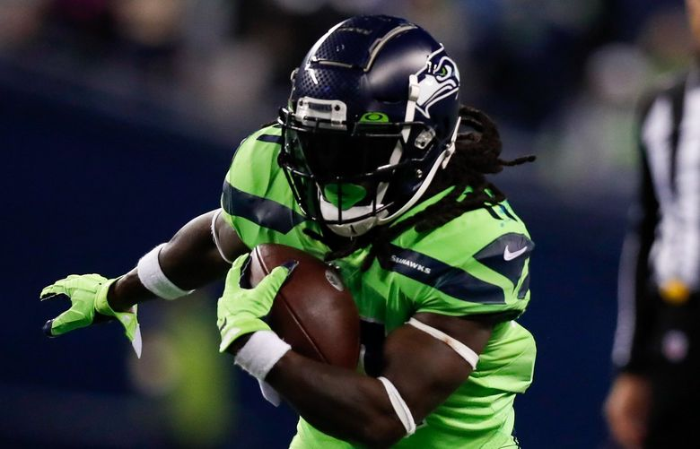 Lumen Field – Seattle Seahawks vs. Los Angeles Rams – 100721  Seattle Seahawks running back Alex Collins rushes against the Los Angeles Rams during the fourth quarter Thursday, Oct. 7, 2021, in Seattle. 218444