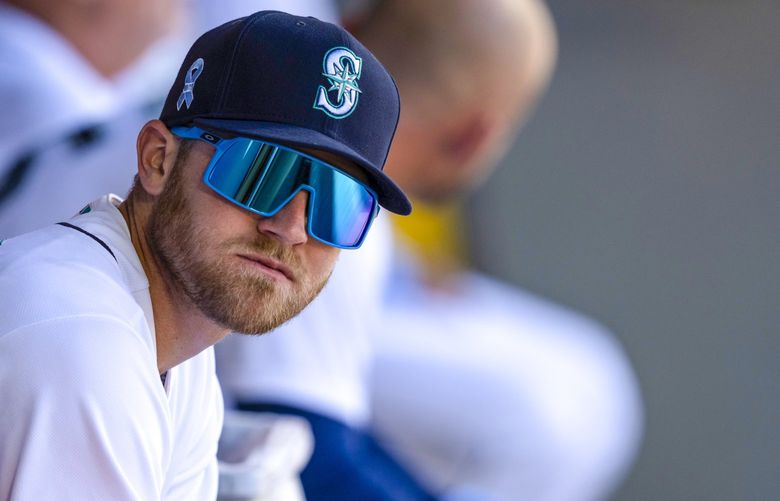 Seattle Mariners' Jake Bauers sits in the dugout before a baseball game against the Tampa Bay Rays, Sunday, June 20, 2021, in Seattle. The Mariners won 6-2 in 10 innings. (AP Photo/Stephen Brashear) _SB13358