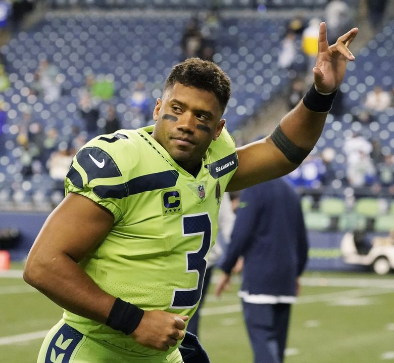 Seattle Seahawks quarterback Russell Wilson waves to fans as he leaves the field after an NFL football game against the Los Angeles Rams, Thursday, Oct. 7, 2021, in Seattle. Wilson suffered a hand injury and the Rams won 26-17. (Elaine Thompson / The Associated Press)