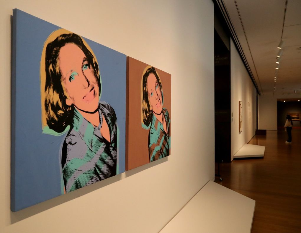 """A portrait of Jane Lang Davis by Andy Warhol greets art lovers at the entrance to the exhibit """"Frisson: The Richard E. Lang and Jane Lang Davis Collection"""" at Seattle Art Museum. (Greg Gilbert / The Seattle Times)"""