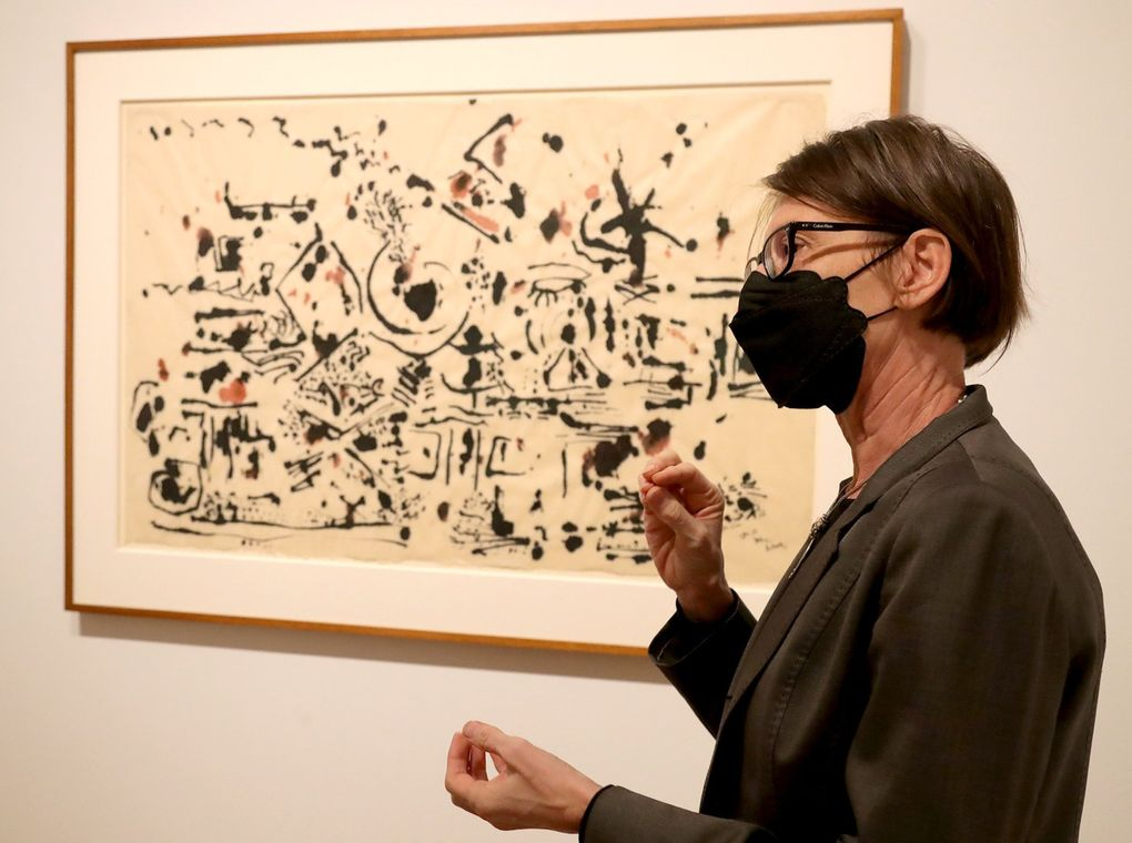 """Catharina Manchanda, SAM's curator of modern and contemporary art, describes the artist's intent in Jackson Pollock's """"Untitled,"""" 1951, one of the works in the """"Frisson"""" exhibit. (Greg Gilbert / The Seattle Times)"""