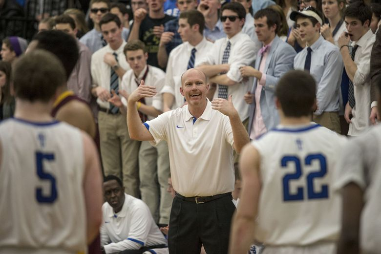 Seattle Prep coach Mike Kelly calls his team over in the final seconds against Lakeside in 2013. (Dean Rutz / The Seattle Times)