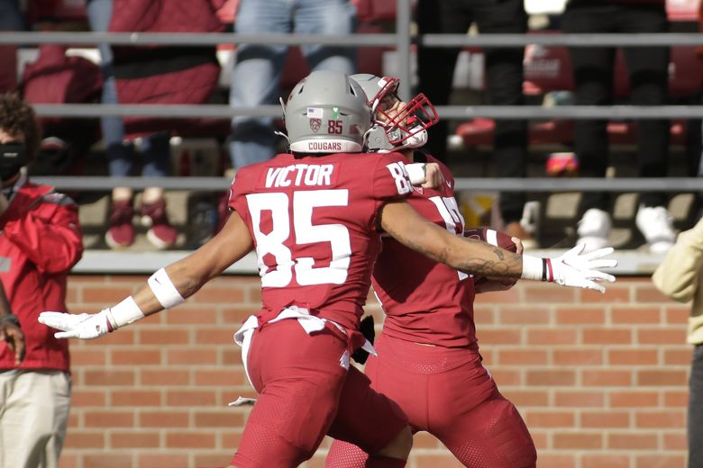 Washington State wide receiver Joey Hobert, right, celebrates as he runs for a touchdown, with wide receiver Lincoln Victor, during the second half against Oregon State on Saturday. (Young Kwak / The Associated Press)