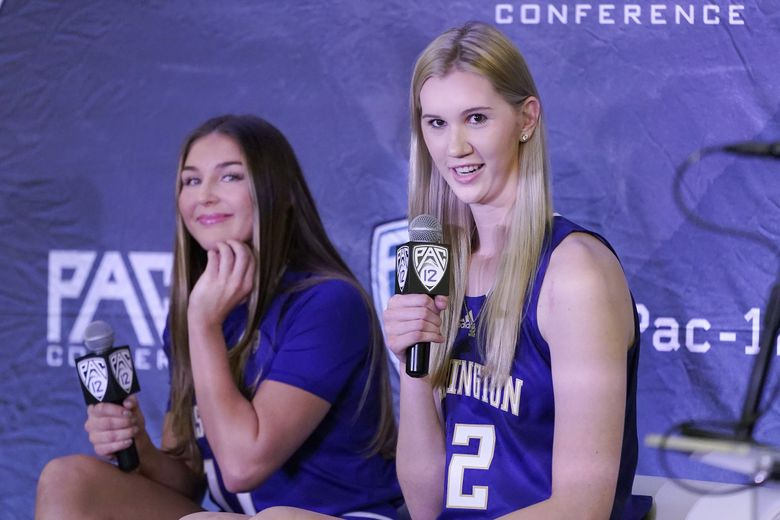 Washington's Nancy Mulkey, right, speaks next to Haley Van Dyke during Pac-12 Conference NCAA college basketball media day Tuesday, Oct. 12, 2021, in San Francisco.  (Jeff Chiu / The Associated Press)