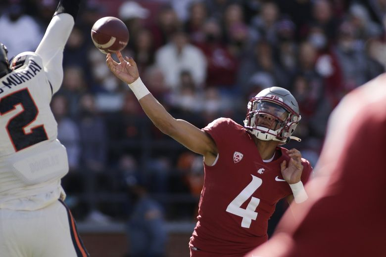 Washington State quarterback Jayden de Laura (4) throws a pass during the first half of  against Oregon State on Saturday. (Young Kwak / The Associated Press)