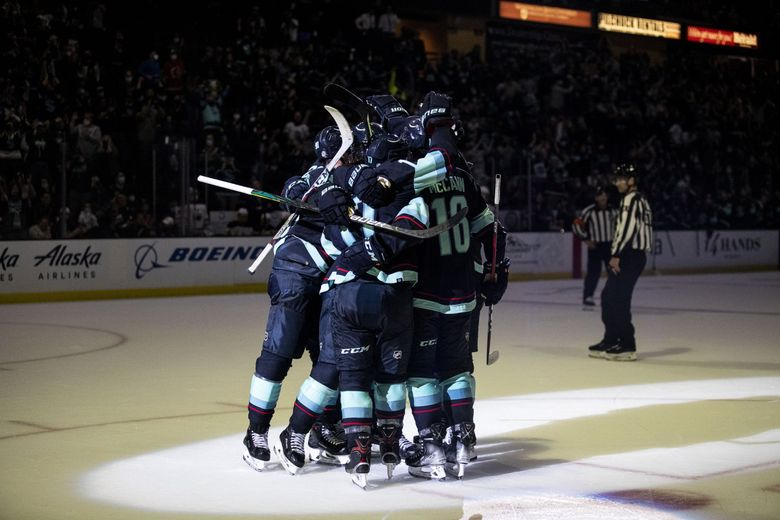 The Kraken celebrate Jaden Schwartz's goal to tie the game in the last minute against Edmonton Oilers at Angel of the Winds Arena on Oct. 1, 2021. (Amanda Snyder / The Seattle Times)