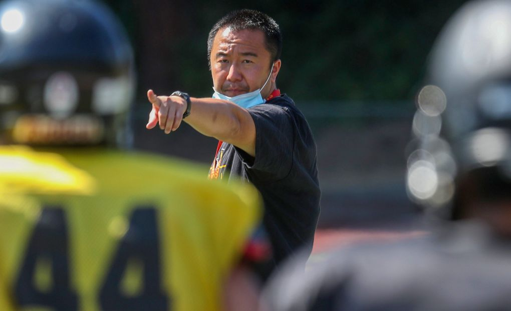 Lincoln high school football coach Masaki Matsumoto keeps things going at a fast pace during a July practice. (Ken Lambert / The Seattle Times)