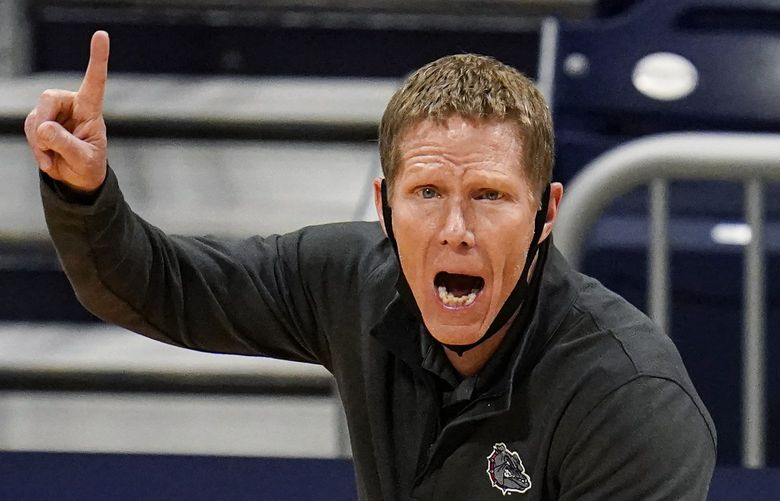 FILE – Gonzaga head coach Mark Few calls a play for his team as they play against Oklahoma in the first half of a second-round game in the NCAA men's college basketball tournament at Hinkle Fieldhouse in Indianapolis, in this Monday, March 22, 2021, file photo. Gonzaga carried a No. 1 ranking all last season before falling a win short of becoming college basketball's first unbeaten national champion in 45 years. Mark Few's Bulldogs start this season in the same position, hoping to complete that final step this time around. The Zags were the runaway top choice in The Associated Press Top 25 men's college basketball preseason poll released Monday, Oct. 18, 2021. (AP Photo/Michael Conroy, File) NY159 NY159