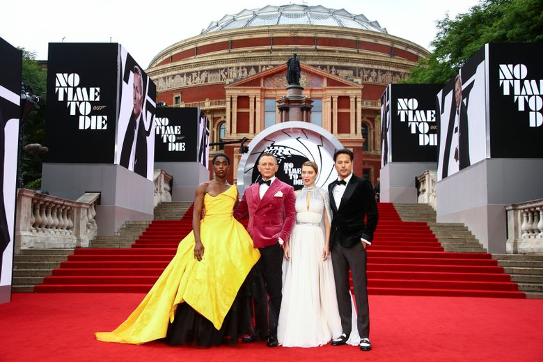 """Lashana Lynch, from left, Daniel Craig, Léa Seydoux and Cary Joji Fukunaga arrive at the world premiere of """"No Time to Die"""" in London last month. (Joel C Ryan / Invision / AP)"""