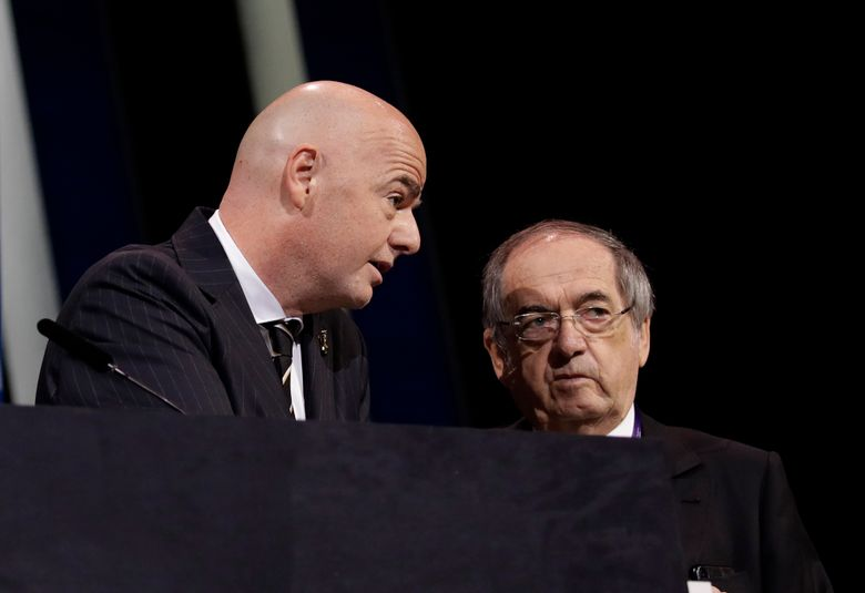 FILE – In this Wednesday, June 5, 2019 file photo, FIFA President Gianni Infantino, left, speaks with French Football Federation President Noel Le Graet before the start of the 69th FIFA congress in Paris. The president of soccer for men's World Cup champion France is not opposed to FIFA's push against European opposition to play the tournament every two years. Noël Le Graët's comments to French sports daily L'Equipe is a significant crack in the unity of 55-nation European soccer body UEFA against the FIFA plan. (AP Photo/Alessandra Tarantino, File)